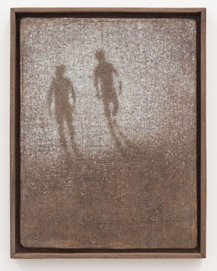 A speckled, faded white outline of two figures walking into the distance is painted on a brown background.