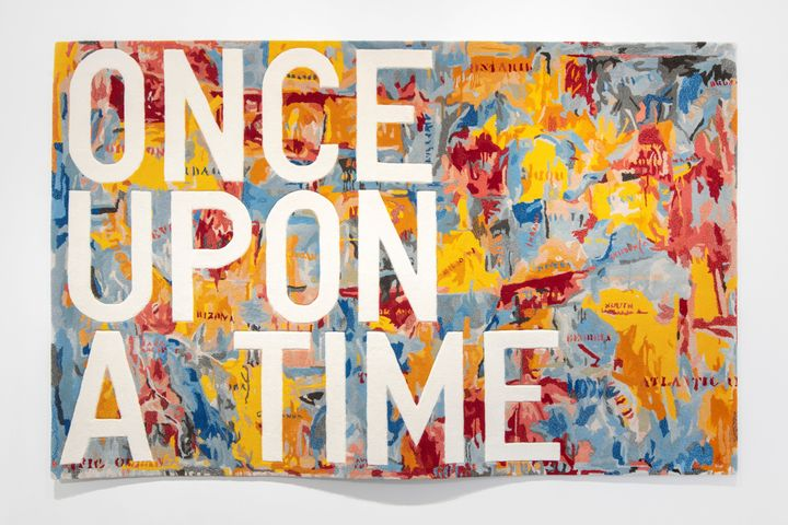 The words 'Once Upon A Time' are printed in capital letters on a rug.