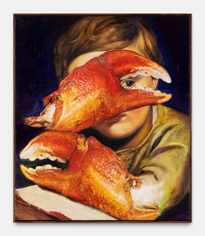 A young boy is painted with an arm that transforms into a large crab claw at his elbow, covering his face. The boy peaks through the claw towards the viewer with one eye.