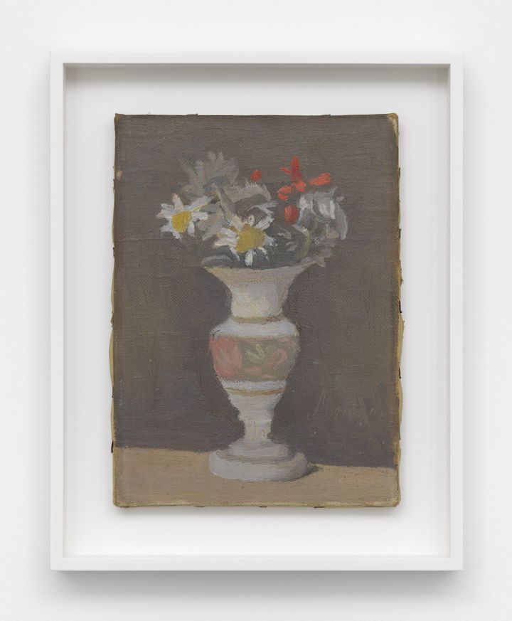 An oil painting on canvas with a few flowers in a white decorative vase by Giorgio Morandi.