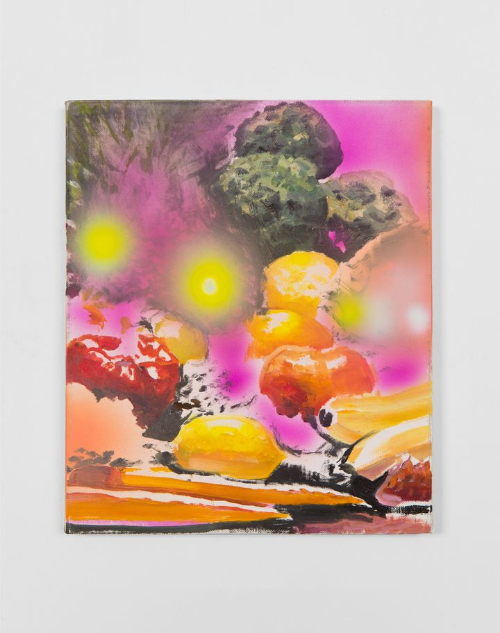 An abstract painting by Van Hanos features pink and yellow hues, with bananas, a pepper, and lemon in the bottom part of the painting and circles of pink and yellow spray paint on top.