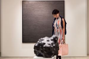 A visitor with 'Anomaly' by Xu WenKai at the 12th Sovereign Asian Art Prize 2016. Photo: Kitmin Lee.
