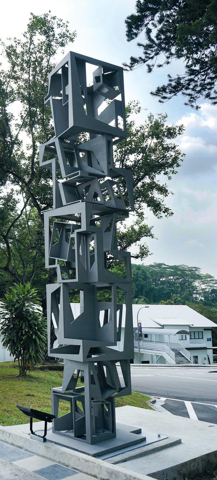 Ding Yi, Pillar (2014). Stainless steel. Edition of 3. Installation view: Gillman Barracks, Singapore. Courtesy ShanghART Gallery, Shanghai/ Beijing/ Singapore.