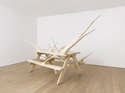 Hugh Hayden, Honorary Natives and the elephant in the middle of the room (2020). Chestnut with steel hardware. 236 x 478 x 160 cm. Exhibition view: American Food, Lisson Gallery, London (12 March–31 July 2020). © Hugh Hayden.
