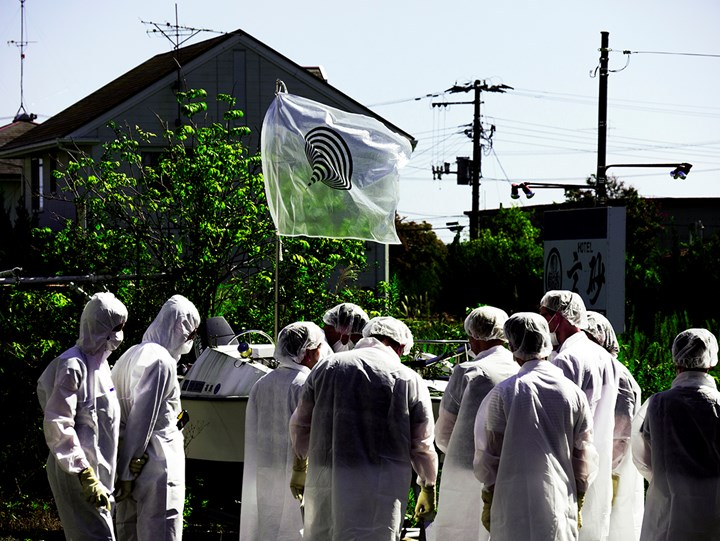 Maintenance trip with flag designed by Naohiro Ukawa, Fukushima exclusion zone, Japan. Courtesy Don't Follow the Wind.