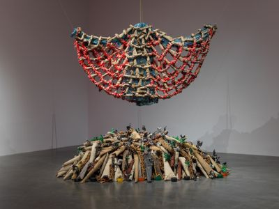 Nari Ward, Carpet Angel (1992). Carpet, plastic bags, plastic bottles, carpet runner, springs, wood screws, and rope. 584.2 x 604.5 x 91.4 cm. Exhibition view: We the People, New Museum, New York (13 February–26 May 2019). Courtesy New Museum. Photo: Maris Hutchinson/EPW Studio.