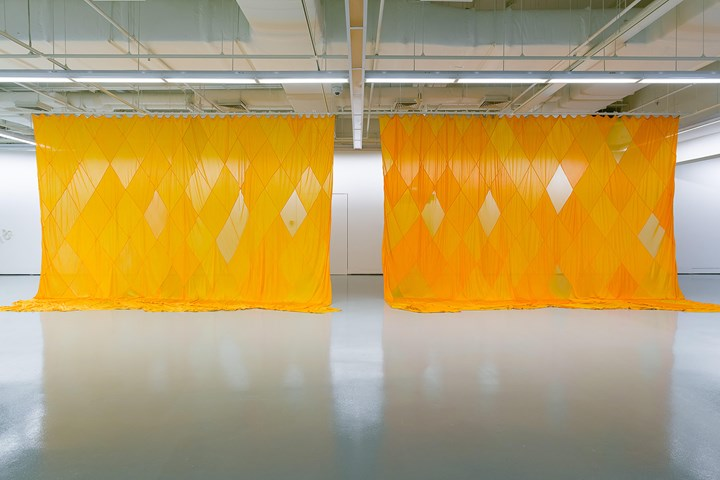 Sriwhana Spong, Villa America (2012). Silk dyed in Fanta. 1600 x 463 cm. Exhibition view: Sriwhana Spong and Maria Taniguchi: Oceanic Feeling, ICA Singapore (20 August–16 October 2016). Courtesy the artists, Michael Lett, Auckland; ICA Singapore.