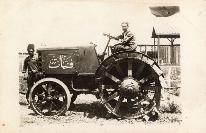 An archival photograph shows a man driving a tractor at the 1924 Adana Agricultural Fair.