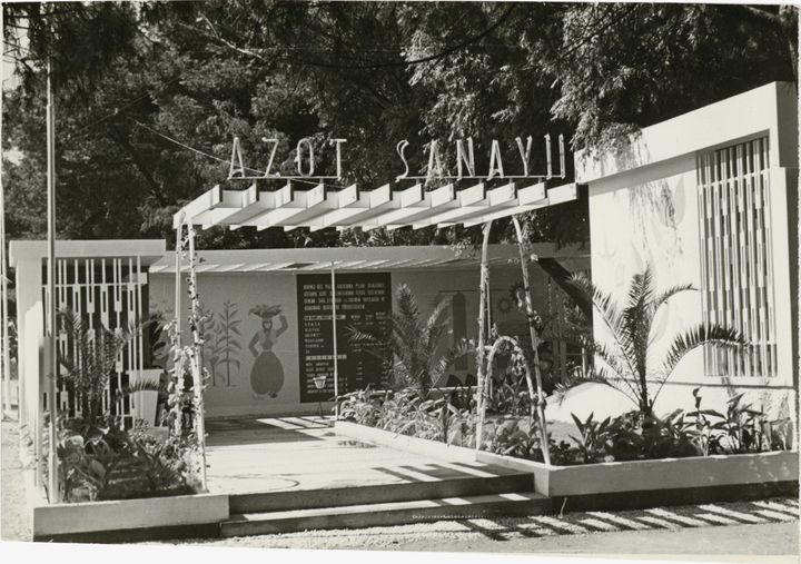 A black and white postcard shows the Nitrogen Pavilion at the İzmir Fair in 1965.