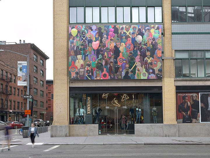 A mural by Derek Fordjour on the outside of the Whitney Museum of American Art shows a crowd of people, their clothing in varying shades of colour.