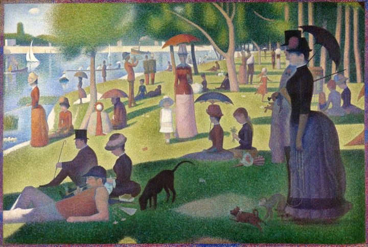 A modernist painting by Georges Seurat features individuals leisurely occupying the banks of the river, lying, sitting, and standing up and many holding umbrellas. There are sail boats in the water.