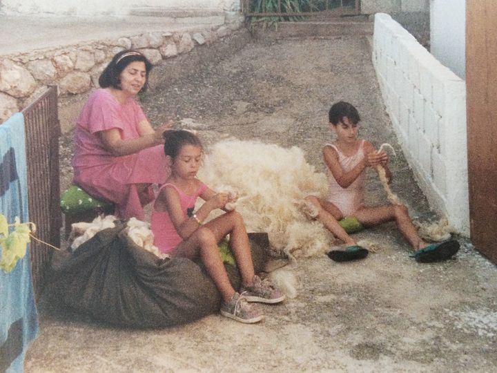 Artist Hana Miletić as a child is pictured with her sister and grandmother sorting through raw wool.