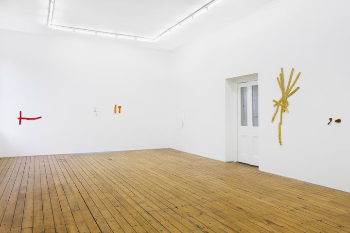 Subtle, fragmentary textile works by Hana Miletić hang in a white gallery space.