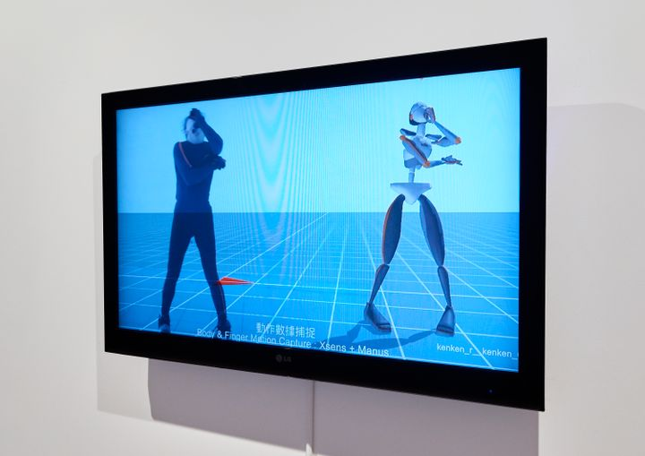 A screen in the gallery space shows motion-capture footage of the artist Lu Yang.