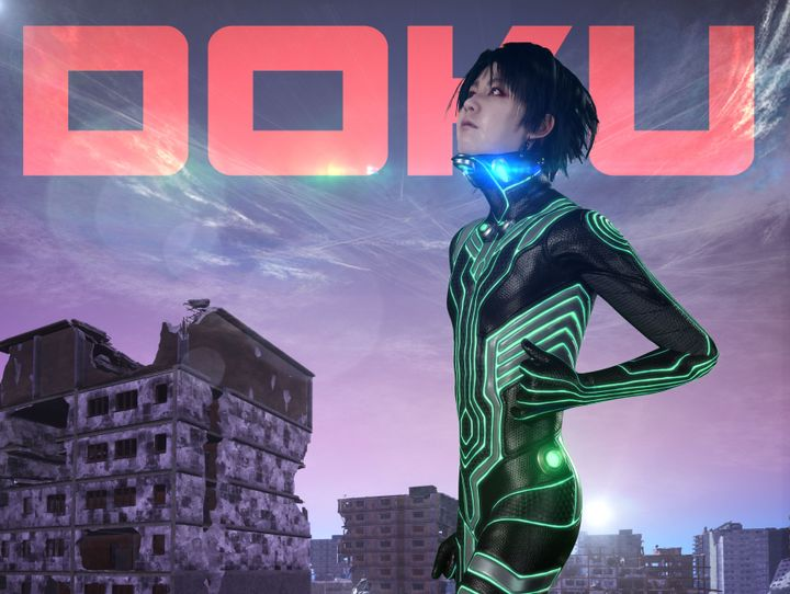 A still from a video by Lu Yang features the artist's alter ego, Doku, dressed in futuristic clothing in an apocalyptic landscape. The word Doku is written in capitals on top of the image.