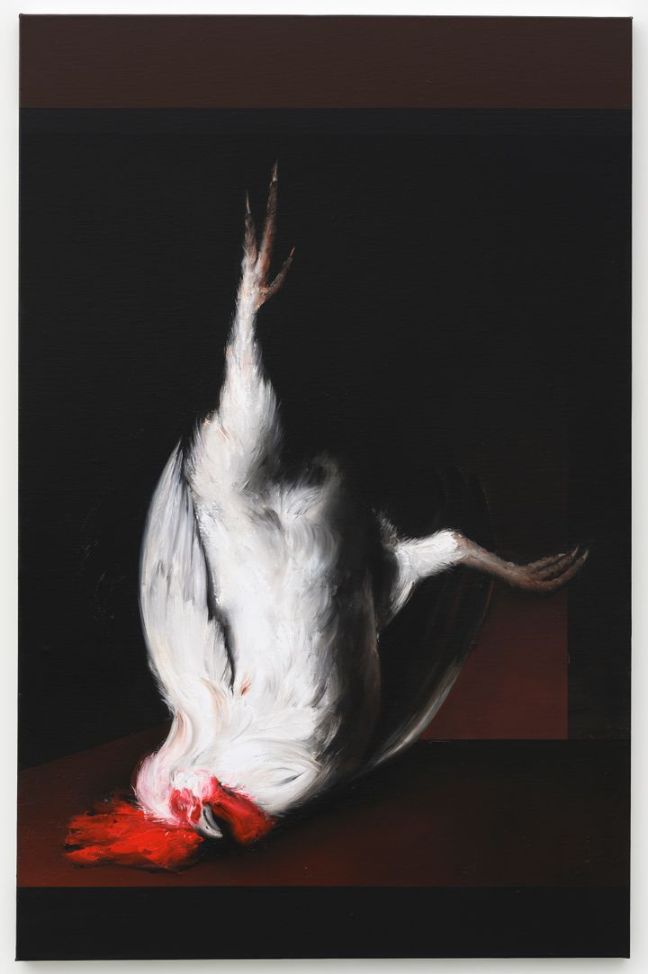 A dead rooster is painted against a black landscape, its white body and red crest standing out boldly against a black background.