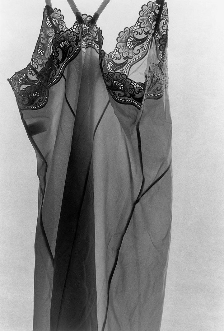 A laced nightdress is photographed in black and white.