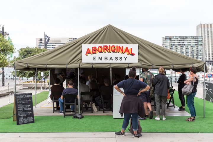 A tent set up outdoors by Richard Bell mimics the Aboriginal Tent Embassy that was placed in front of Parliament House in Canberra in 1972
