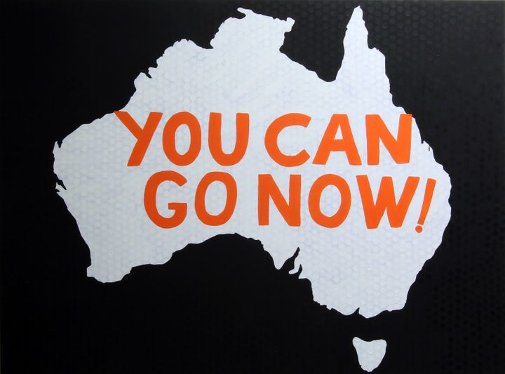 A black and white painting by Richard Bell of Australia, with words painted orange reading 'You can go now'