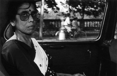 Kushal Ray, Manju Chatterjee, the protagonist of Intimacies, is in a taxi on her way to teach philosophy in a college (2001). Prints from film scans, Kodak Trix, 20.3 cm x 15.2 cm. © Kushal Ray.