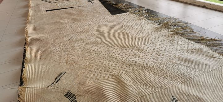 On the floor, an incomplete mat is visible.