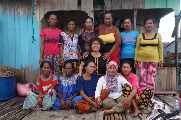 Artist Yee I-Lann is pictured with her collaborators: a group of women from the island of Sabah in Borneo.