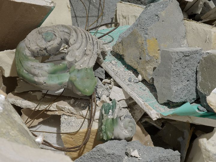 A close-up photograph of rubble in the gallery space that makes up an installation by Yu Ji.
