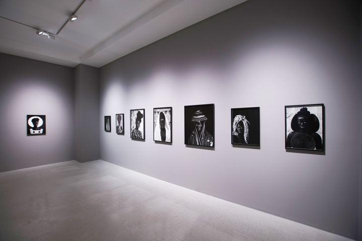 Exhibition of Zanele Muholi artworks hung vertically across Pearl Lam Galleries in Hong Kon