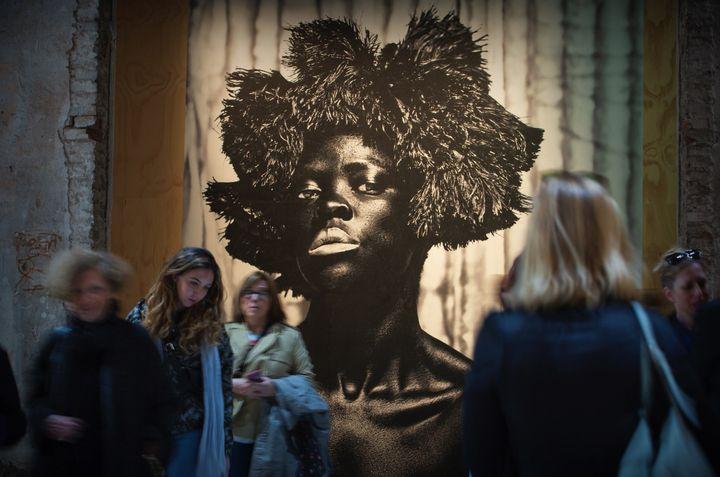 Poster of Zanele Muholi artwork, with a women gazing at the viewer at la Biennale di Venezia