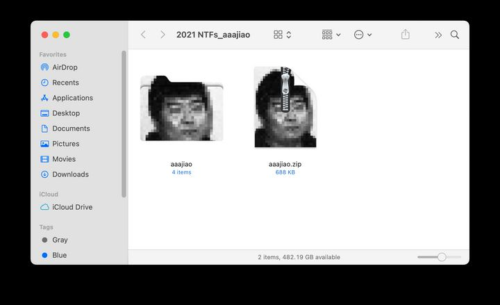 Zip files of Aaajiao's blurred black and white portrait are shown in a file database of a computer.