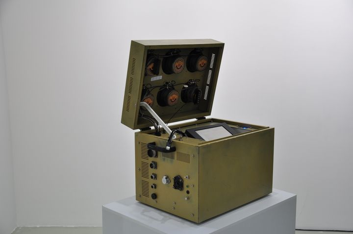 A mechanic box is placed atop a pedestal with its lid open.