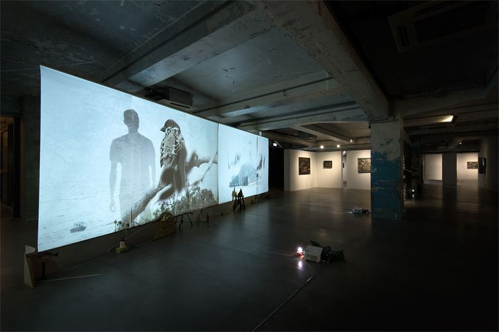 Lam Tung-pang, A Day of two Suns (2019). Video projections on loop with no sound on paper, objects. Exhibition view: Saan Dung Gei, Blindspot Gallery, Hong Kong (26 March–11 May 2019). Courtesy Blindspot Gallery.