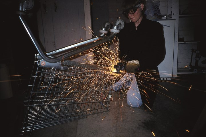 Inga Svala Thórsdóttir pulvarising a shopping trolley in 1993 as part of 'Thor's Daughter's Pulverization Service' (1993–ongoing). Courtesy the artist.