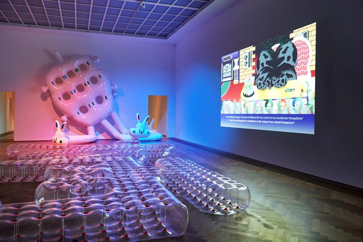 Wong Ping, Rabbit 3 in 1 (2019). Plastic. Approx 600 x 730 x 340 cm; Wong Ping's Fables 2 (2018). HD film, colour, sound, Cantonese with English and German subtitles. 13 min; loop (left to right). Exhibition view: Golden Shower, Kunsthalle Basel (18 January–5 May 2019). Courtesy the artist and Edouard Malingue Gallery