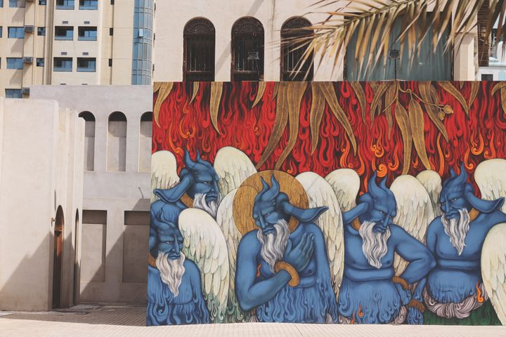 Khadim Ali, Standing Flames (2019, from the series 'Flowers of Evil'). Acrylic, industrial paints, Dutch metal gold leaf on MDF. 1785 x 539 cm. In collaboration with Bamyan Art Space. Commissioned by Sharjah Art Foundation. Exhibition view: Leaving the Echo Chamber, Sharjah Biennial 14 (7 March–10 June 2019). Courtesy the artist. Photo: Sharjah Art Foundation.