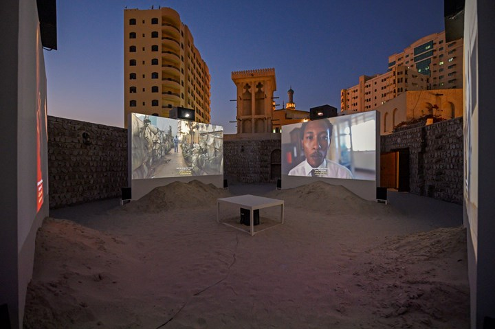 Tuấn Andrew Nguyễn, The Specter of Ancestors Becoming (2019). 4-channel video installation: colour, 7.1 surround sound; inkjet on canvas, oil on canvas, graphite on paper, C-prints, sand. 28 min; dimensions variable. Commissioned by Sharjah Art Foundation. Produced by Sharjah Art Foundation with the additional production support from the San Francisco Museum of Modern Art. Exhibition view: Leaving the Echo Chamber, Sharjah Biennial 14 (7 March–10 June 2019). Courtesy the artist. Photo: Sharjah Art Foundation.