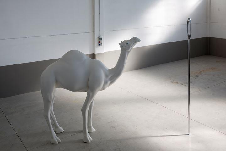 John Baldessari, Camel (Albino) Contemplating Needle (Large) (2013). Fibreglass, aluminium, stainless steel, acrylic and paint, edition of 3. Camel: 271.7 x 81.2 x 269.2 cm. Needle: 320 x 13 x 13 cm. Courtesy Beyer Projects.
