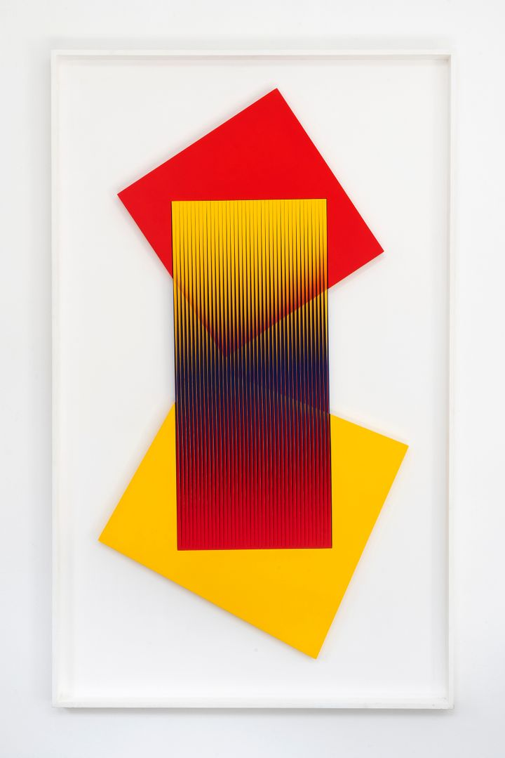 Alberto Biasi's geometric artwork titled with red and yellow accent being exhibited at M77 in Milan