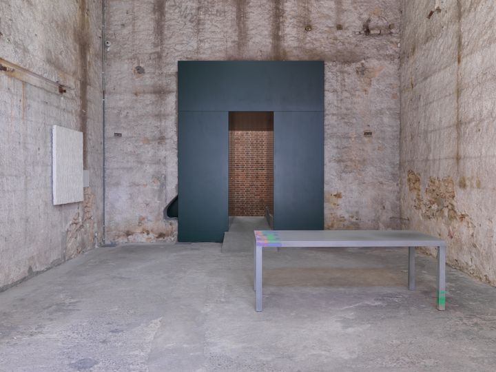 A table stands in the empty gallery space of Rodeo in Athens.