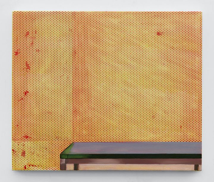 A smooth table-top in the lower right-hand corner is depicted beneath a yellow wall covered in red perforations.