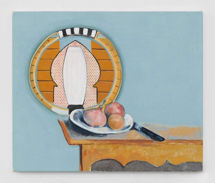 A painting by Dexter Dalwood depicts three orange-pink fruit in a bowl on a table beside a knife. The table is positioned to the lower right- hand corner. The wall above it is rendered sky-blue and features a surrealistic framed image.