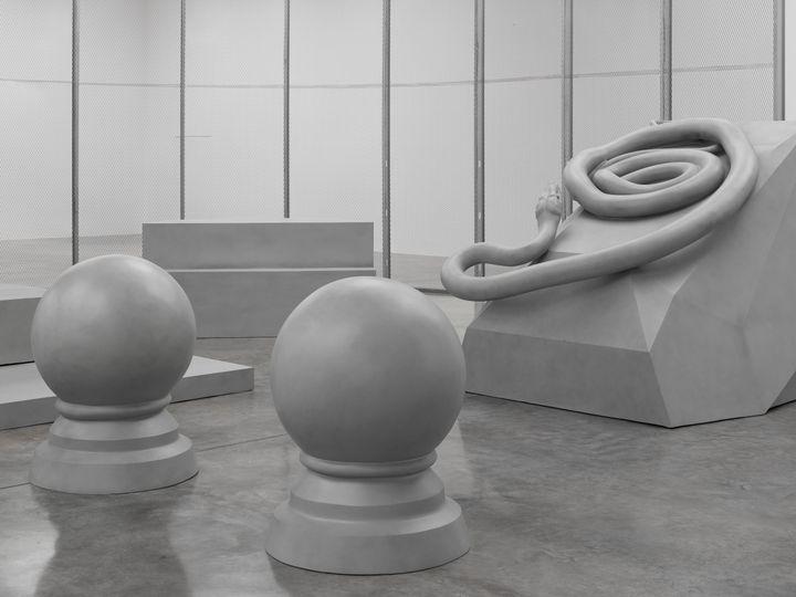 Artist Liu Wei's artworks depicting round and intestine-like grey fibreglass aluminium sculptures
