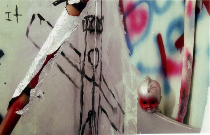 An early installation by Manuel Mathieu featuring graffiti on the wall and a dolls head
