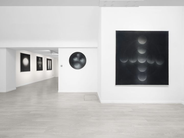 A series of black and white geometric works by Marco Tirelli line the white walls of Cardi Gallery in London.