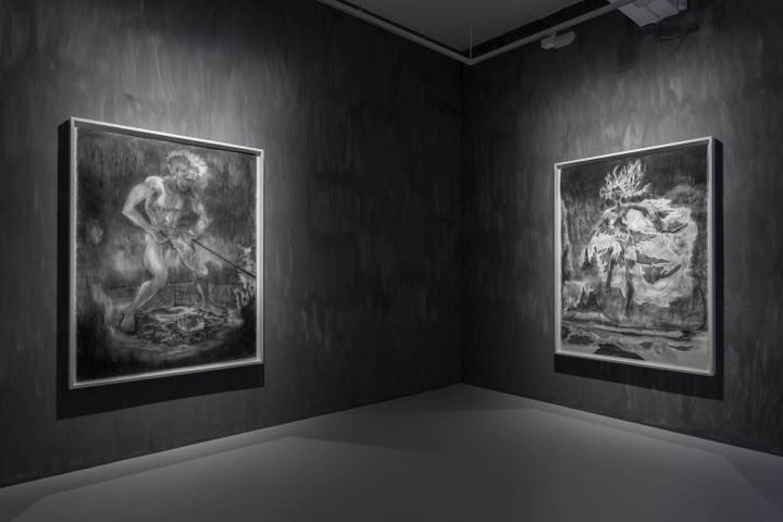 Two large-scale drawings in black and white by Sedrick Chisom are placed upon grey walls in the gallery space.