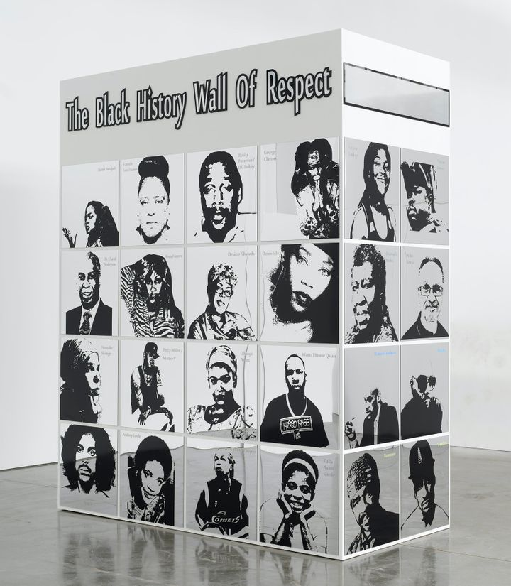 A large rectangular structure by Lauren Halsey is freestanding in the gallery space. It reads 'Black History Wall of Fame' and features mirrored portraits of individuals such as Octavia E. Butler and Lauryn Hill.