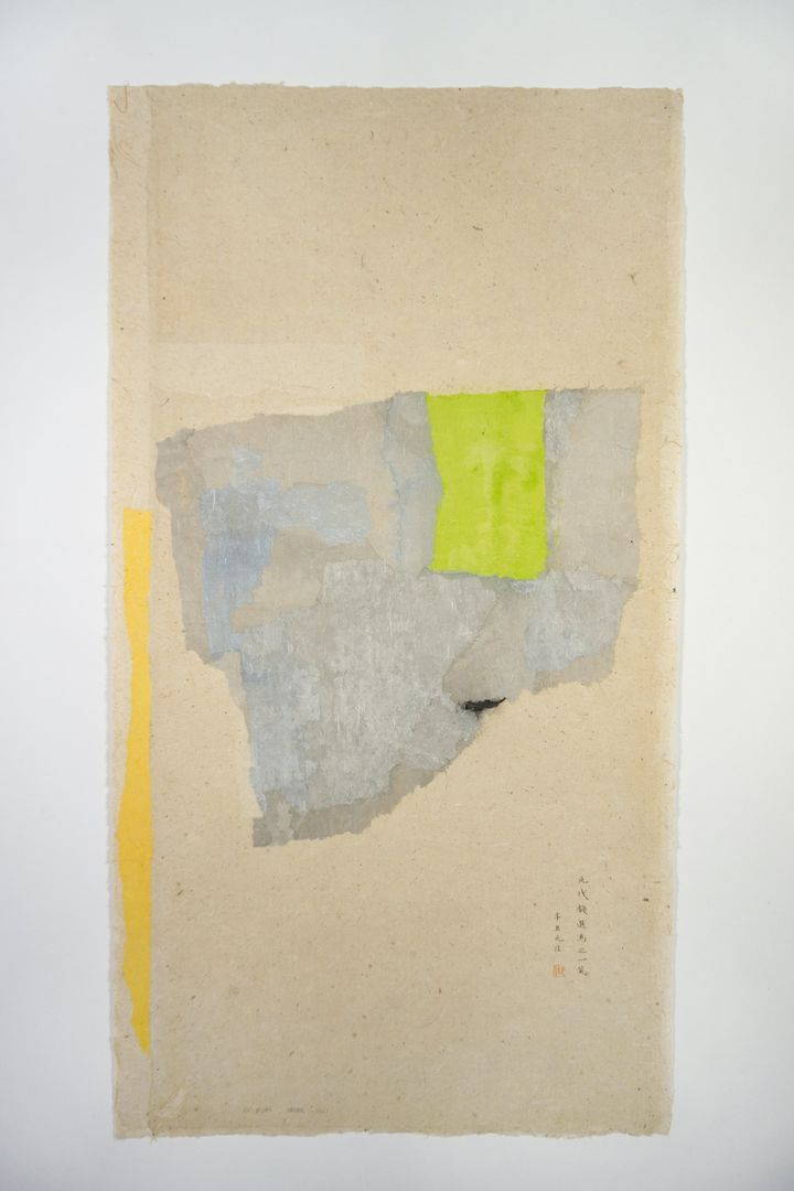 A light green segment of paper is collaged on top of semi-translucent pieces of layered grey paper. The collage, by Wei Jia, is pasted onto beige Xuan paper.
