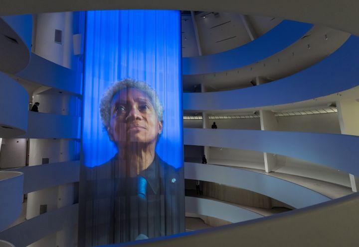 Curtain projection of Wu Tsang's artwork portraying Glenn-Copeland singing inside the Guggenheim Museum