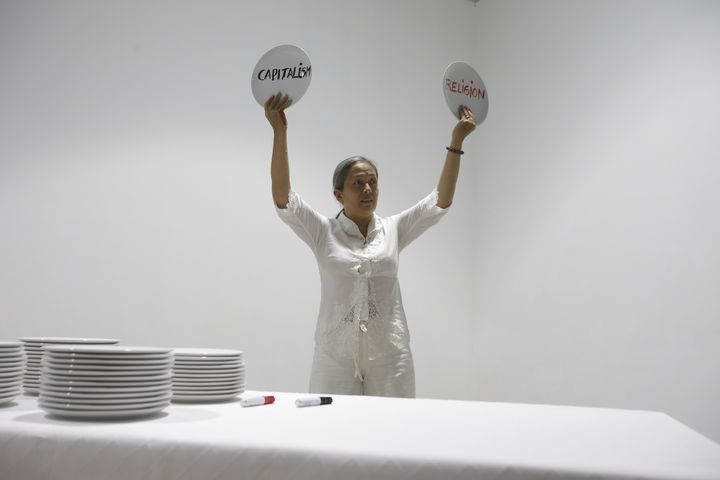 Arahmaiani Feisal performing Breaking Words at FIELD MEETING Take 6: Thinking Collections, Alserkal Avenue, Dubai (25–26 January 2019). Courtesy Asia Contemporary Art Week.