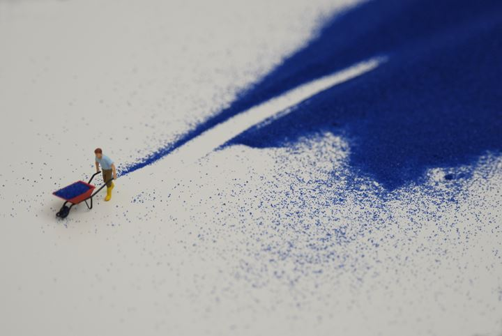 Liliana Porter, Forced Labor (blue sand) II (2008) (detail), part of the series 'Forced Labor'. Figurine and blue sand on shelf. 25.4 x 109.22 x 7.62 cm. Courtesy the artist.